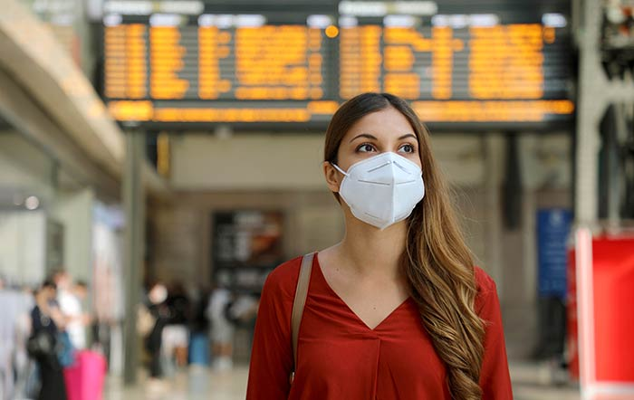 Traveller Woman At Airport Wearing Mask